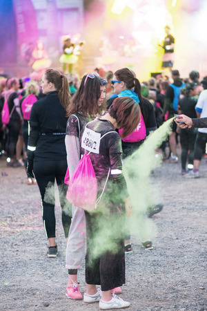 STOCKHOLM, SWEDEN - SEPT 18, 2016: Colorful happy people at the Color Run Night Edition in Stockholm. Editorial