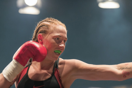 STOCKHOLM, SWEDEN - SEPT 10, 2016: Patricia Berghult (SWE) vs Magyar Kinga (HUN) in the female super lightweight. The winner takes it all event. Berghult winner TKO.