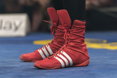 STOCKHOLM, SWEDEN - SEPT 10, 2016: Shoes of the winner Patricia Berghult (SWE) against Magyar Kinga (HUN) in the female super lightweight. The winner takes it all event. Berghult winner TKO. Editorial