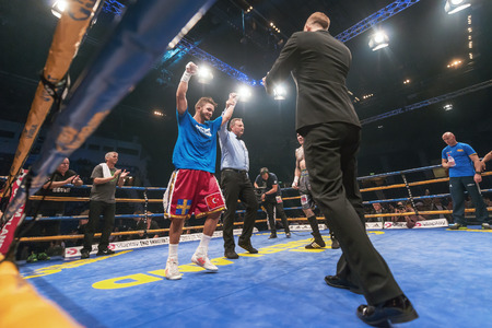 ringside: STOCKHOLM, SWEDEN - SEPT 10, 2016: After the match between Anthony Yigit (SWE) vs Armando Robles (MEX) in super lightweight at The winner takes it all event in boxing. Winner Anthony Yigit