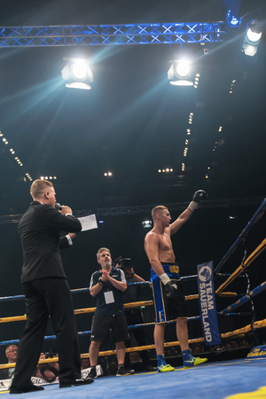 the heavyweight: STOCKHOLM, SWEDEN - SEPT 10, 2016: Announcer between Otto Wallin (SWE) vs Osbourne Machimana (RSA) in heavyweight at The winner takes it all event in boxing. Winner Otto Wallin Editorial
