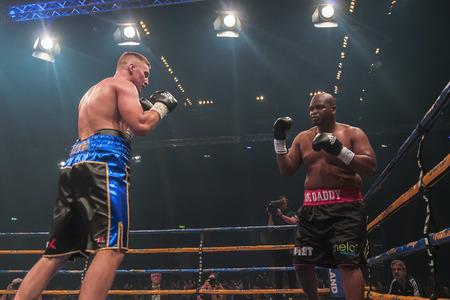 rsa: STOCKHOLM, SWEDEN - SEPT 10, 2016: Match between Otto Wallin (SWE) vs Osbourne Machimana (RSA) in heavyweight at The winner takes it all event in boxing. Winner Otto Wallin