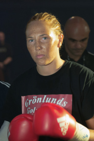 ringside: STOCKHOLM, SWEDEN - SEPT 10, 2016: Before the match Patricia Berghult (SWE) vs Magyar Kinga (HUN) in the female super lightweight. The winner takes it all event. Berghult winner TKO.