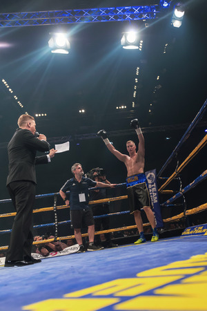 otto: STOCKHOLM, SWEDEN - SEPT 10, 2016: Announcer between Otto Wallin (SWE) vs Osbourne Machimana (RSA) in heavyweight at The winner takes it all event in boxing. Winner Otto Wallin Editorial