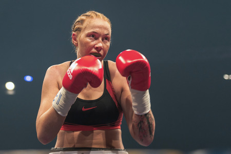 lightweight: STOCKHOLM, SWEDEN - SEPT 10, 2016: Patricia Berghult (SWE) vs Magyar Kinga (HUN) in the female super lightweight. The winner takes it all event. Berghult winner TKO.