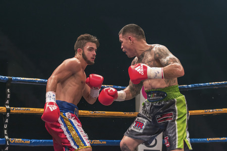 bout: STOCKHOLM, SWEDEN - SEPT 10, 2016: Match between Anthony Yigit (SWE) vs Armando Robles (MEX) in super lightweight at The winner takes it all event in boxing. Winner Anthony Yigit