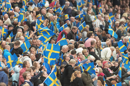 prix: STOCKHOLM - SEPT 24, 2016: Swedish supporters at Stockholm FIM Speedway Grand Prix at Friends Arena in Stockholm.