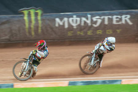 STOCKHOLM - SEPT 24, 2016: Jason Doyle chasing the leader Greg Hancock at Stockholm FIM Speedway Grand Prix at Friends Arena in Stockholm. Editorial