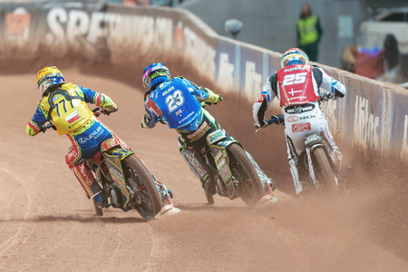 STOCKHOLM - SEPT 24, 2016: Back of three riders side by side at Stockholm FIM Speedway Grand Prix at Friends Arena in Stockholm.