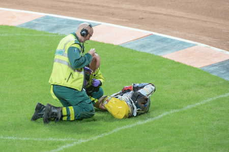 STOCKHOLM - SEPT 24, 2016: Medics after the crash from Kim Nilsson at Stockholm FIM Speedway Grand Prix at Friends Arena in Stockholm. He was ok