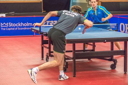 samuel: STOCKHOLM, SWEDEN - NOV 17, 2016: Carl Ahlander (SWE) vs Samuel Walker (ENG) at the table tennis tournament SOC at the arena Eriksdalshallen in Stockholm. Editorial