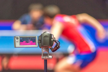 STOCKHOLM, SWEDEN - NOV 17, 2016: Camcorders recording the players at the table tennis tournament SOC at the arena Eriksdalshallen in Stockholm.