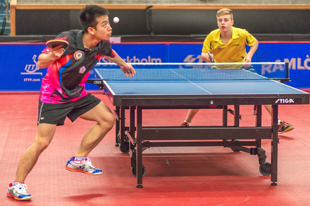 STOCKHOLM, SWEDEN - NOV 17, 2016: Truls Moreard (SWE) vs Ting Liao (TPE) at the table tennis tournament SOC at the arena Eriksdalshallen in Stockholm. Editorial