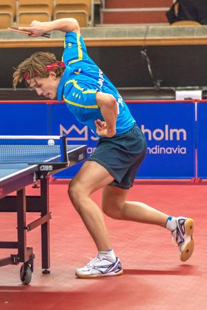 STOCKHOLM, SWEDEN - NOV 17, 2016: Carl Ahlander (SWE) vs Samuel Walker (ENG) at the table tennis tournament SOC at the arena Eriksdalshallen in Stockholm. Editorial