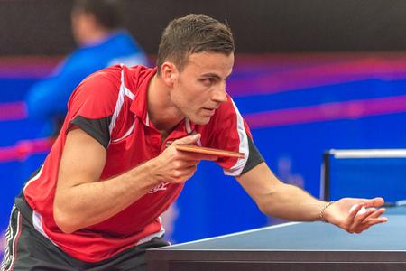 STOCKHOLM, SWEDEN - NOV 18, 2016: Player at the table tennis tournament SOC at the arena Eriksdalshallen in Stockholm. Editorial
