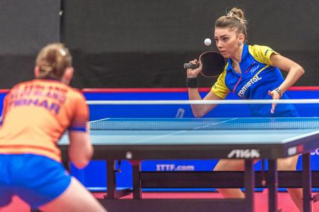 rou: STOCKHOLM, SWEDEN - NOV 18, 2016: Bernadette Szocs (ROU) vs Britt Eerland (NED) at the table tennis tournament SOC at the arena Eriksdalshallen in Stockholm.