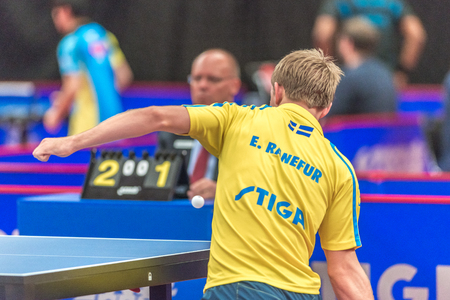 gameplay: STOCKHOLM, SWEDEN - NOV 18, 2016: Elias Ranefur (SWE) vs Jonathan Groth (DEN) at the table tennis tournament SOC at the arena Eriksdalshallen in Stockholm.