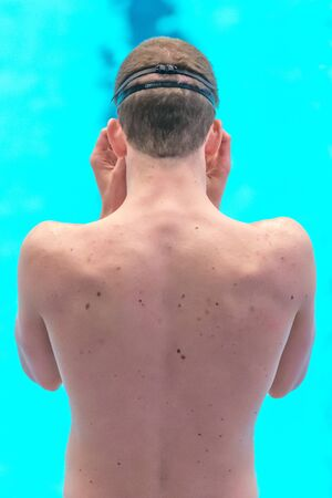 STOCKHOLM, SWEDEN - NOV 5, 2016: Back of a young swimmer at the National Swedish swim championships at Eriksdalsbadet. Editorial