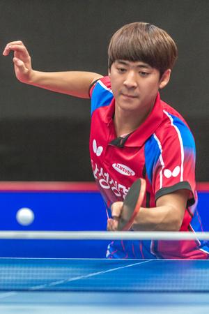 STOCKHOLM, SWEDEN - NOV 18, 2016: Chi Chien Lai (TPE) vs Ganghyeon Park (KOR) at the table tennis tournament SOC at the arena Eriksdalshallen in Stockholm.