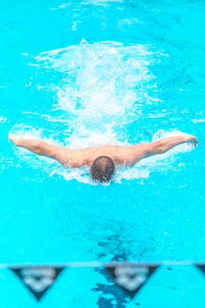 STOCKHOLM, SWEDEN - NOV 5, 2016: Butterfly swim at the National Swedish swim championships at Eriksdalsbadet.