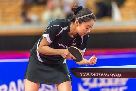 STOCKHOLM, SWEDEN - NOV 19, 2016: Melek Hu (TUR) vs Jihee Jeon (KOR) in the table tennis tournament SOC at the arena Eriksdalshallen in Stockholm.
