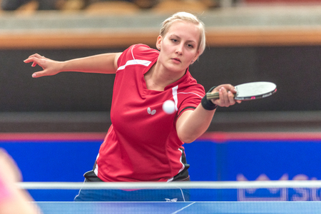 gameplay: STOCKHOLM, SWEDEN - NOV 18, 2016: Barbora Balazova (SVK) vs Hyowon Suh (KOR) at the table tennis tournament SOC at the arena Eriksdalshallen in Stockholm.