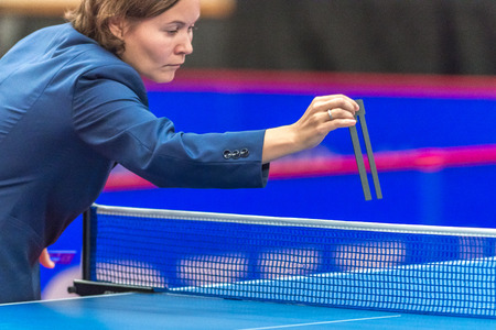 gameplay: STOCKHOLM, SWEDEN - NOV 18, 2016: Official measuring the net at the table tennis tournament SOC at the arena Eriksdalshallen in Stockholm. Editorial