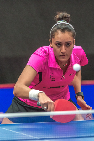 STOCKHOLM, SWEDEN - NOV 18, 2016: Yuka Ishigaki (JPN) vs Manika Batra (IND) at the table tennis tournament SOC at the arena Eriksdalshallen in Stockholm.