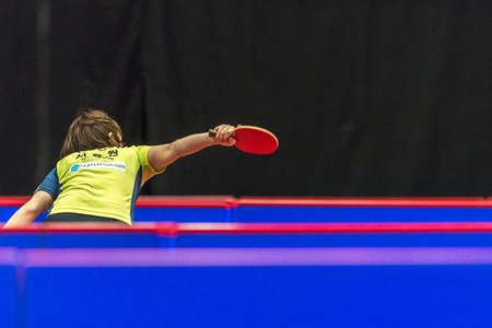 elite: STOCKHOLM, SWEDEN - NOV 19, 2016: I Ching Cheng (TPE) vs Hyowon Suh (KOR) in the table tennis tournament SOC at the arena Eriksdalshallen in Stockholm.
