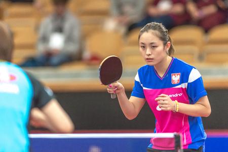 STOCKHOLM, SWEDEN - NOV 19, 2016: Kasumi Ishikawa (JPN) vs Qian Li (POL) in the table tennis tournament SOC at the arena Eriksdalshallen in Stockholm. Editorial