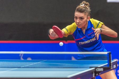 STOCKHOLM, SWEDEN - NOV 18, 2016: Bernadette Szocs (ROU) vs Britt Eerland (NED) at the table tennis tournament SOC at the arena Eriksdalshallen in Stockholm.