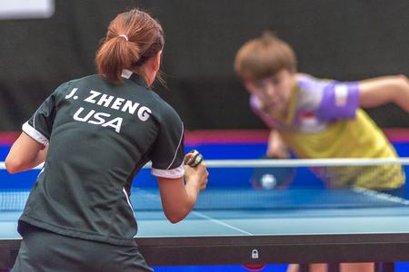 gameplay: STOCKHOLM, SWEDEN - NOV 18, 2016: Jiaqi Zheng (SA) vs Yihan Zhou (SGP) at the table tennis tournament SOC at the arena Eriksdalshallen in Stockholm. Editorial