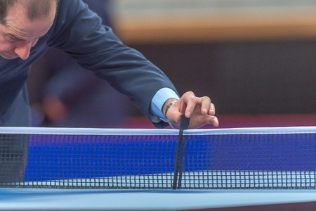 judge players: STOCKHOLM, SWEDEN - NOV 19, 2016: Official measuring the hight of the net at the table tennis tournament SOC at the arena Eriksdalshallen in Stockholm. Editorial