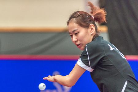 STOCKHOLM, SWEDEN - NOV 18, 2016: Jiaqi Zheng (SA) vs Yihan Zhou (SGP) at the table tennis tournament SOC at the arena Eriksdalshallen in Stockholm. Editorial