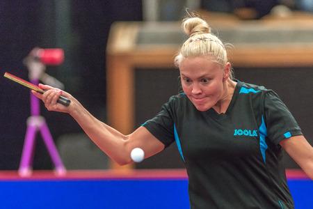 gameplay: STOCKHOLM, SWEDEN - NOV 18, 2016: Miyu Kato (JPN) vs Georgina Pota HUN) at the table tennis tournament SOC at the arena Eriksdalshallen in Stockholm.