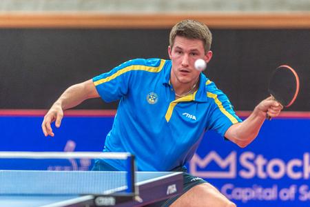 STOCKHOLM, SWEDEN - NOV 18, 2016: Joao Monteiro (POR) vs Kristian Karlsson (SWE) at the table tennis tournament SOC at the arena Eriksdalshallen in Stockholm. Editorial