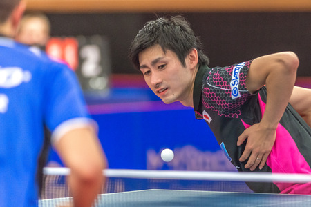 double game: STOCKHOLM, SWEDEN - NOV 19, 2016: Hachard and Ouaiche vs Matsudaira and Ueda in the table tennis double tournament SOC at the arena Eriksdalshallen in Stockholm.