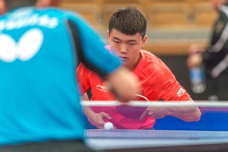 STOCKHOLM, SWEDEN - NOV 18, 2016: Xu Song (CHN) vs Marcos Freitas (POR) at the table tennis tournament SOC at the arena Eriksdalshallen in Stockholm.