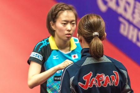 elite: STOCKHOLM, SWEDEN - NOV 19, 2016: Kasumi Ishikawa (JPN) vs Qian Li (POL) in the table tennis tournament SOC at the arena Eriksdalshallen in Stockholm. Editorial