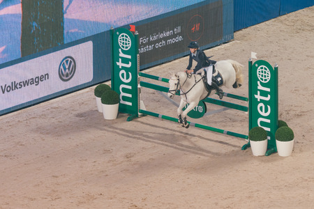 olivia: SOLNA, SWEDEN - NOV 26, 2016: Olivia Ytterell at the Prince Carl Philip prize event in ponny jumping at the Sweden International Horse Show in Friends arena.