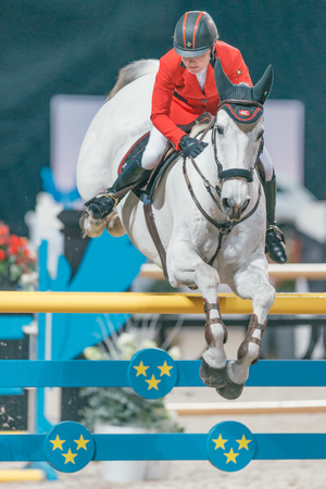 SOLNA, SWEDEN - NOV 27, 2016: Helena Persson at the Sweden Grand Prix in the Sweden International Horse Show at Friends arena.