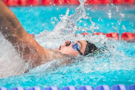 backstroke: STOCKHOLM, SWEDEN - NOV 6, 2016: Swimmers at the National Swedish swim competition at Eriksdalsbadet. Editorial