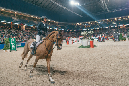 SOLNA, SWEDEN - NOV 27, 2016: Janika Sprunger at the Sweden Grand Prix in the Sweden International Horse Show at Friends arena. Editorial