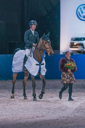 SOLNA, SWEDEN - NOV 27, 2016: Winner Douglas Lindlow at the Sweden Masters Last Man Standing in the Sweden International Horse Show at Friends arena. Editorial