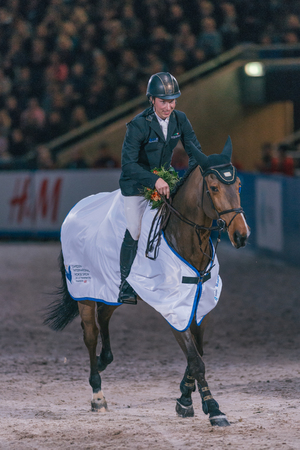 SOLNA, SWEDEN - NOV 27, 2016: Winner Douglas Lindlow at the Sweden Masters Last Man Standing in the Sweden International Horse Show at Friends arena. Editorial