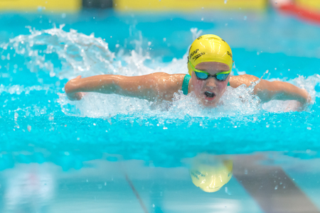 STOCKHOLM, SWEDEN - NOV 6, 2016: Female Butterfly swimmer at the National Swedish swim competition at Eriksdalsbadet.