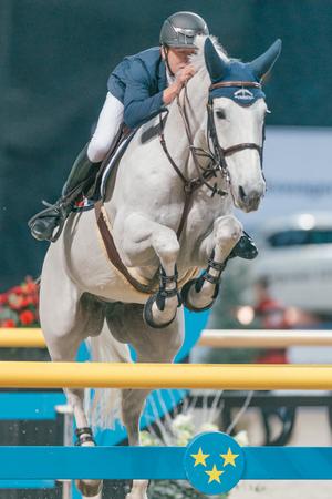 SOLNA, SWEDEN - NOV 27, 2016: Bertram Allen at the Sweden Grand Prix in the Sweden International Horse Show at Friends arena.