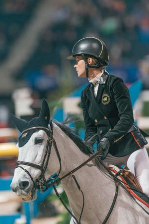 SOLNA, SWEDEN - NOV 27, 2016: Malin Baryard Johnsson at the Sweden Grand Prix in the Sweden International Horse Show at Friends arena. Editorial