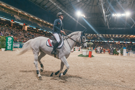 malone: SOLNA, SWEDEN - NOV 27, 2016: Bertram Allen at the Sweden Grand Prix in the Sweden International Horse Show at Friends arena.