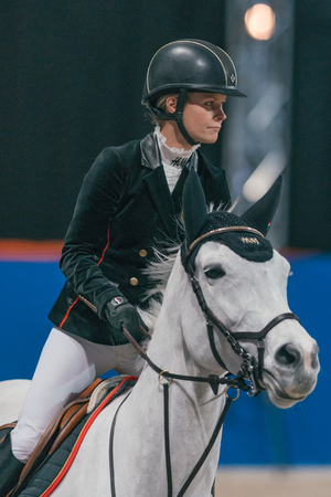 SOLNA, SWEDEN - NOV 27, 2016: Malin Baryard Johnsson at the Friends Christmas Speed Jumping in the Sweden International Horse Show at Friends arena. Editorial